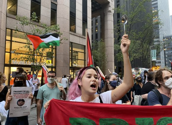 Protesters Storm MoMA with Palestinian Flags and Spoons